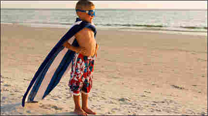 Little boy dressed as a superhero
