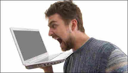 man yelling at his computer