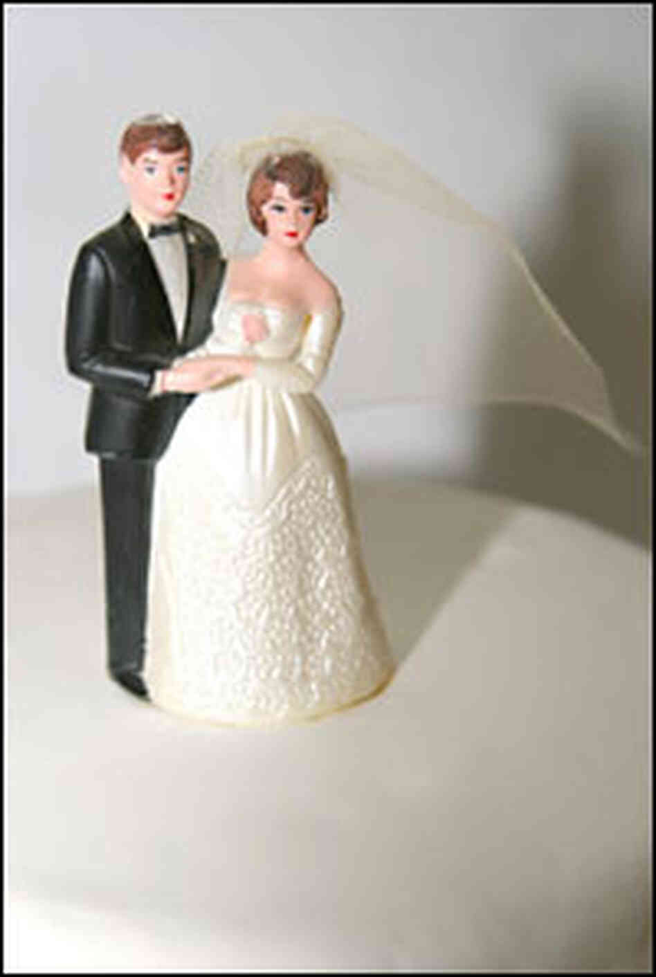 Bride and groom figurines from a wedding cake
