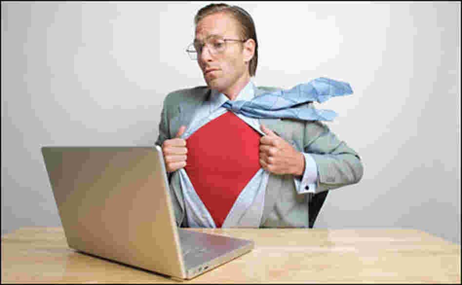 man at laptop revealing superhero outfit