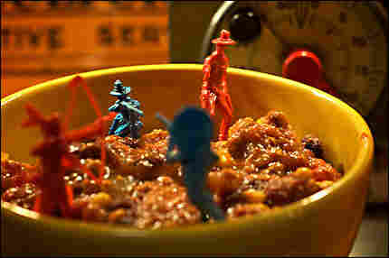 Toy Army men sinking into a bowl of chili