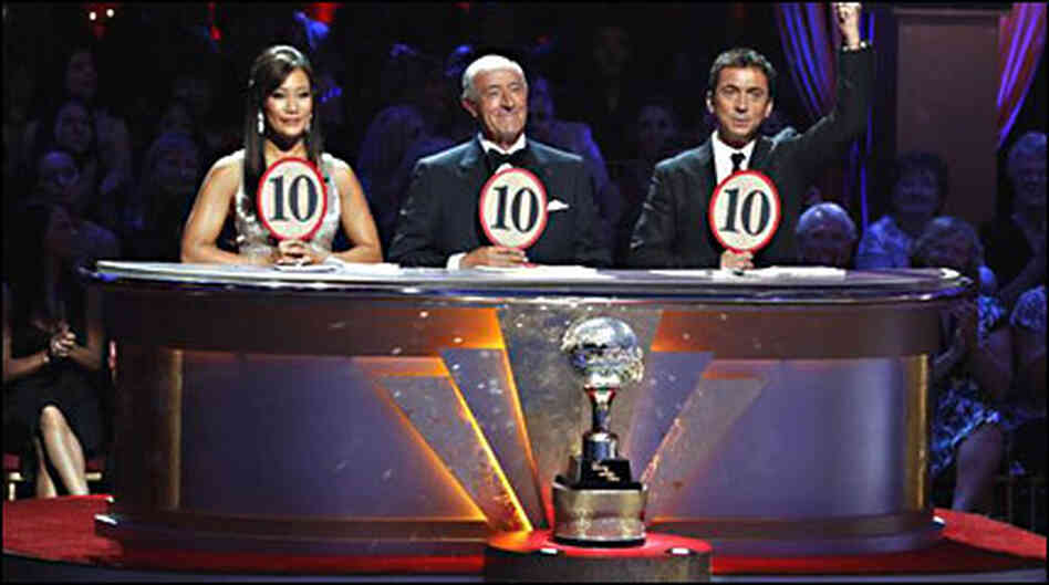 The judges of Dancing With The Stars hold up their scoring paddles