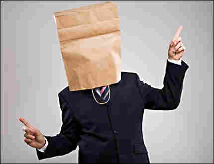 a man with a paper bag over his head