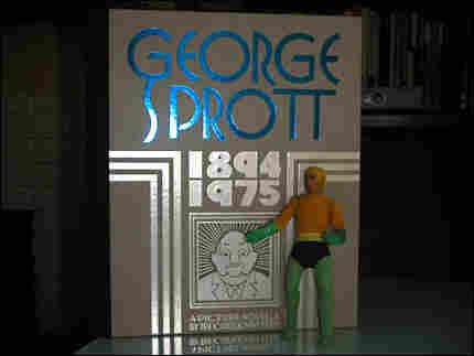 Action figure standing beside great big book