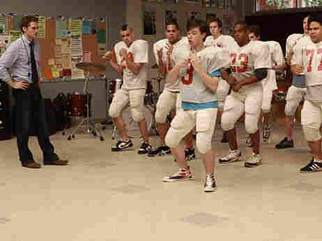 Kurt (Chris Colfer) teaches the football team to dance on Fox's 'Glee.'