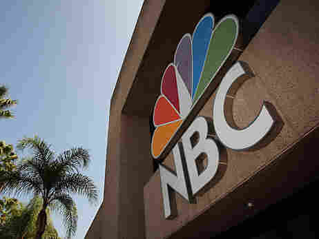 The NBC Studios building with a large sign.