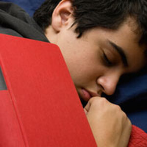 guy sleeping with a book on his face.
