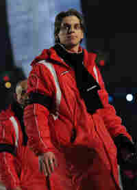 A member of Georgia's Olympic delegation marches in the opening ceremonies in a black scarf and armb