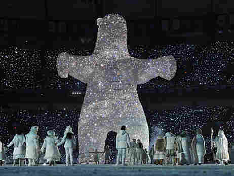 A giant bear made of lights emerges during the opening ceremonies of the Vancouver Winter Olympics o