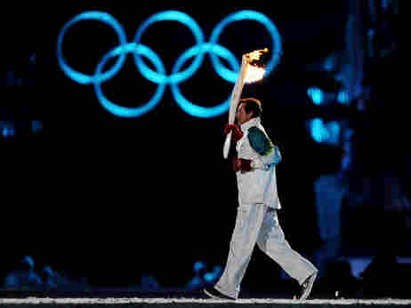 Wayne Gretzky carries the Olympic torch at the openi
