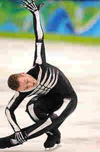 Belgian skater Kevin van der Perren competes in the short program at the 2010 Winter Olympics.