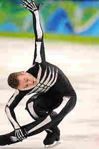 Belgian skater Kevin van der Perren competes in the short program at the 2010 Winter Olympics.