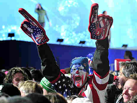 A fan cheers for Lindsey Vonn during the 2010 Winter Olympics.