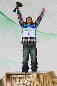 Shaun White celebrates his snowboarding gold medal.