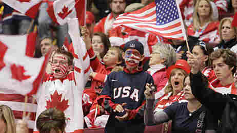 USA and Canada fans cheer at Sunday night's hockey game.