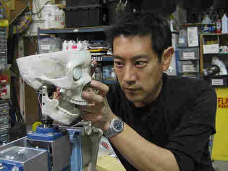 Grant Imahara works on the robot skeleton.