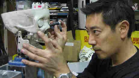 Grant Imahara works on the roboskeleton.