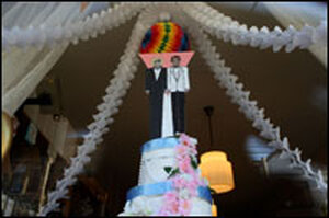 A mock wedding cake with two grooms on display in San Francisco.