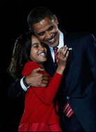 President-elect Barack Obama embraces his daughter, after he claims victory.