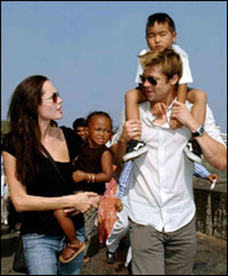 Angelina Jolie and Brad Pitt with two of their adopted kids, Zahara and Maddox.