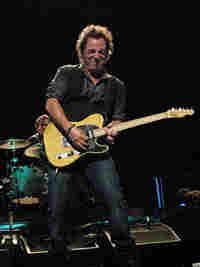 Bruce Springsteen rocks it hard.