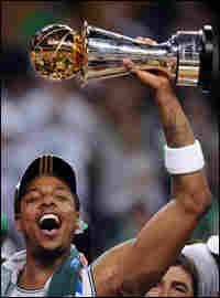 Paul Pierce celebrates the Celtics' NBA Finals win with his MVP trophy.
