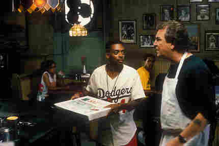 Spike Lee (left, with Danny Aiello as Sal) both directs and stars in Do The Right Thing. Lee's cha
