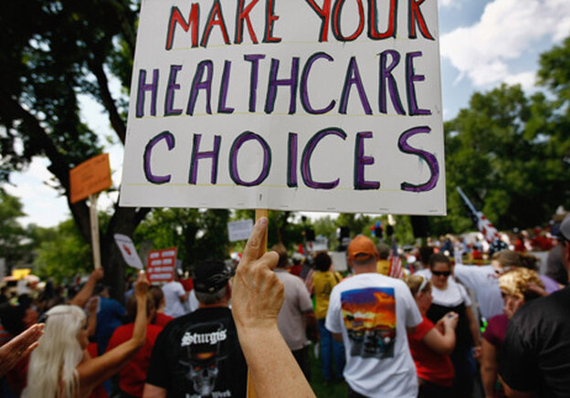 Prostesters demonstrate against Democratic-sponsored healthcare reform at a rally ahead of President