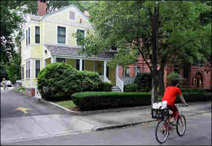 A bicyclist passes by the home of Harvard Scholar Henry Louis Gates in Cambridge, Mass. Gates was