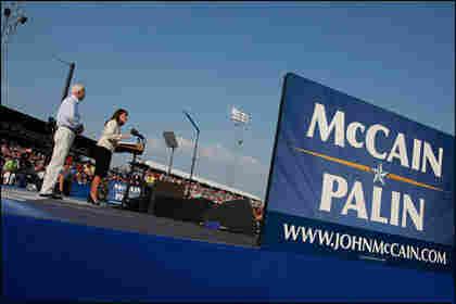 Presumptive Republican presidential nominee Sen. John McCain (R-AZ) listens as presumptive Republi