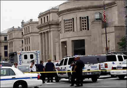 Police gather in front of the Holocaust Museum in Washington, D.C., following yesterday's shooting