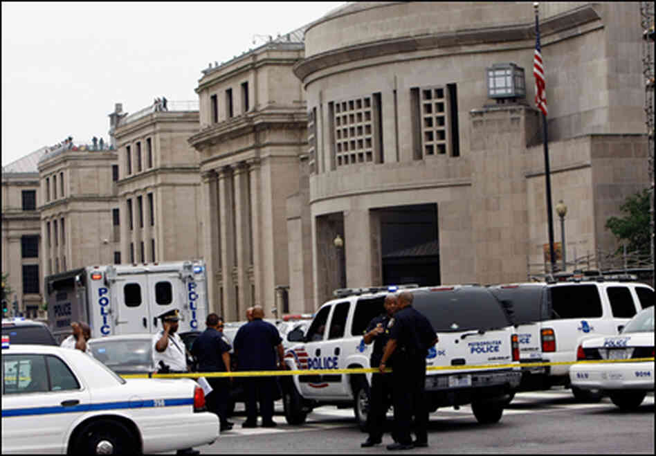 Police gather in front of the Holocaust Museum in Washington, D.C., following yesterday's