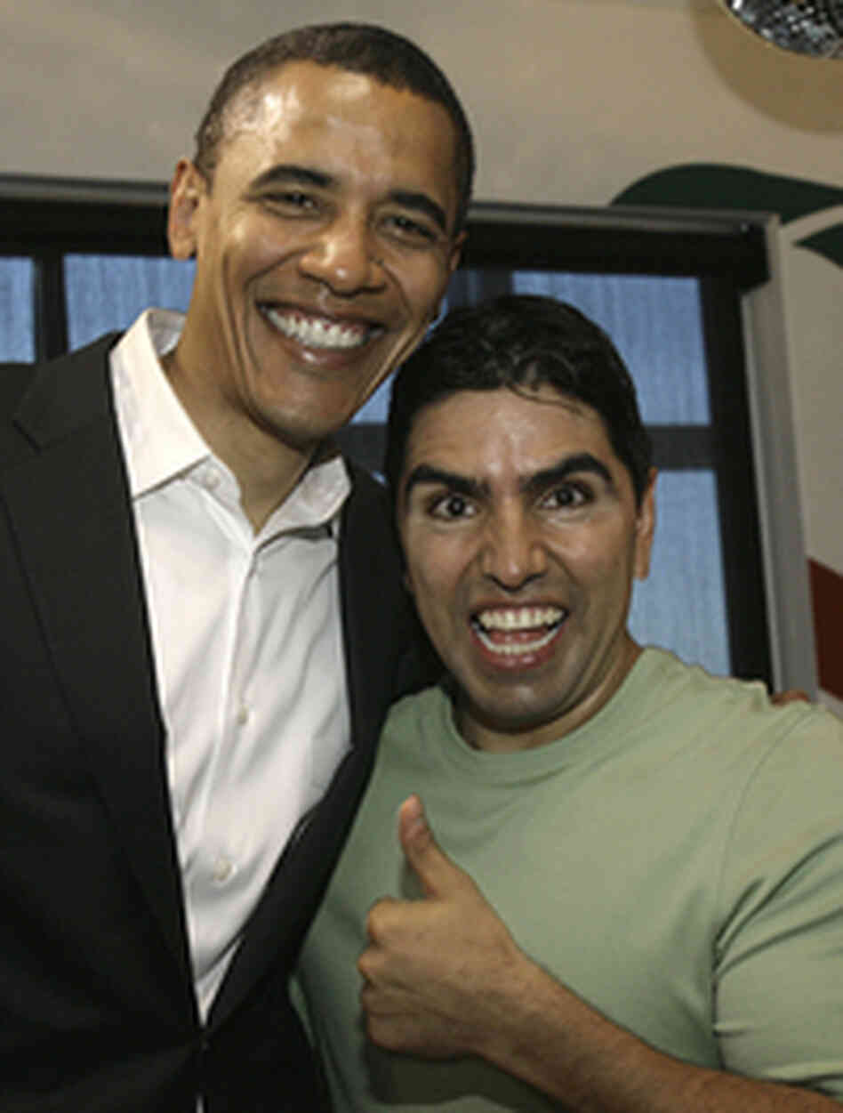 "Then-presidential hopeful Barack Obama poses with radio host Eddie ""Piolin"" Sotelo following a cha"