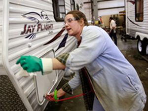 A worker at Jayco, Inc., the country's third largest RV maker, does the final inspection on a trav