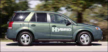 The Saturn Vue Green Line Hybrid sport utility vehicle is driven at the General Motors Saturn plan