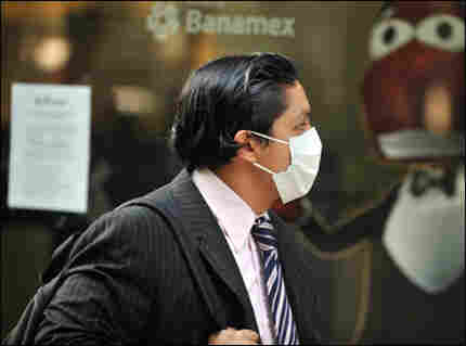 A man wearing a face mask walks along Reforma Avenue in Mexico City. Mexico was preparing Monday t