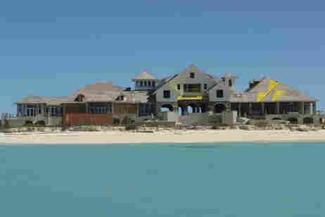 An unfinished resort hotel is seen on the small undeveloped island of West Caicos, in the Turks and