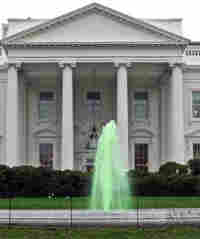 The fountain in front of the White House flows with green water, Tuesday, March 17, 2009, in honor