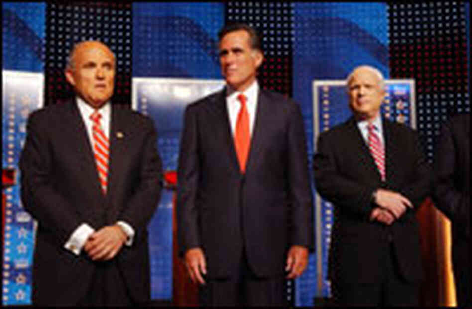 Former New York City Mayor Rudy Giuliani (left), former Massachusetts Gov. Mitt Romney (center) and