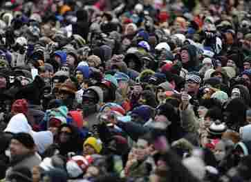 Crowds watching Obama.