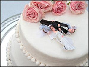 Broken figurines on a wedding cake