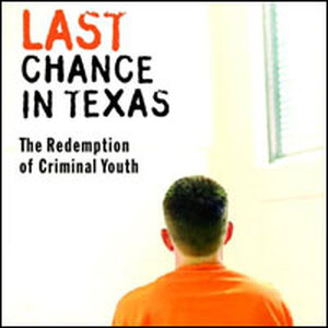 A young Texas inmate in orange jumpsuit, with back to camera.
