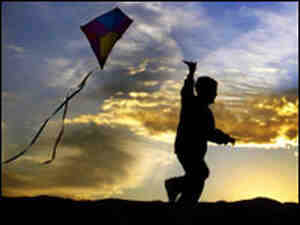 Kid flying a kite primary