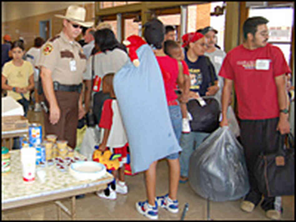 Evacuees arrive in an Austin, Texas shelter, Sept. 24.