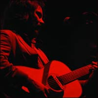 Jeff Tweedy loves red lights! And playing guitar on the road.