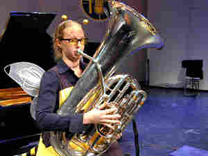 Carol Jantsch, dressed in bumble bee attire, plays the tuba