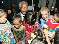 United Nations Secretary-General Kofi Annan  and his wife Nane talk with HIV-infected children at a hospital in Bangkok. Credit: Reuters