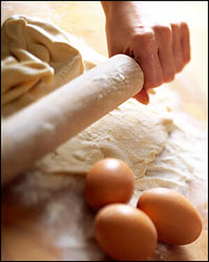 Rolling pin, eggs, flour