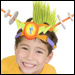 Boy transforms into a mohawked-alien with Giggle Gear, a cap with mix-and-match parts.