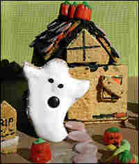 A graham cracker haunted house and a ghost made of whole wheat bread and Fluff